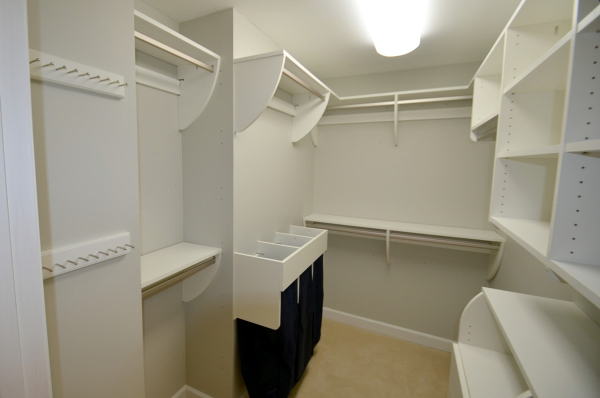 "Light, clean and ""Curvy."" Awesome example of the versatility of ""Closet Curves."" Single and double hanging, shelves, drawers, and a triple drawstring bag hamper set-up. Excellent utility, excellent value!"