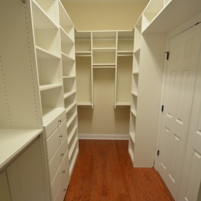 """This design """"lives"""" in floor and wall mount galleries.  Sometimes it just makes more sense to combine styles, and we did.  Extra tall ceilings allowed additional shelves above the double hanging and over the doors."""
