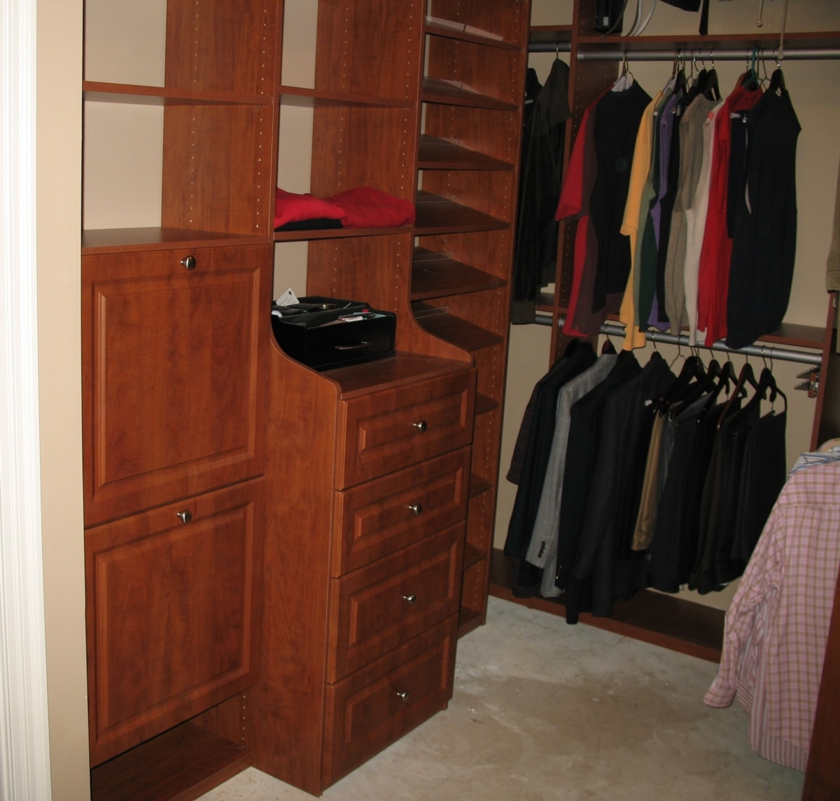 Lovely In This Awesome Closet, A Deep Drawer Hutch Is Flanked By Dual Tilting  Hampers And An Angled Shoe Display.