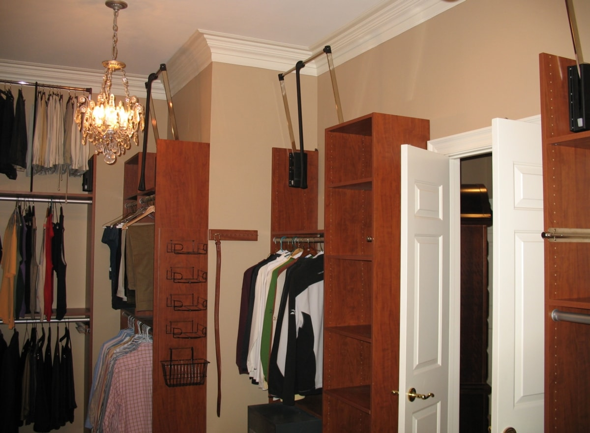 In This Closet, Tall Ceilings And Tall Panels Allow For Triple Hanging. Pull  Down (pneumatic) Lifts Make It Convenient.