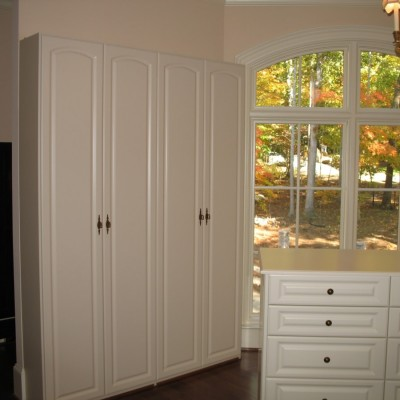"""Double tall cabinets provide the """"pedestals"""" for almost 100 pairs of shoes."""