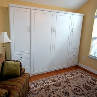 Full time home office, with file storage and more.  The upper side cabinets offer pull-out wardrobe rods for hanging clothes, can be replaced with shelves if needed.  The queen sized wall bed is ready for guests.