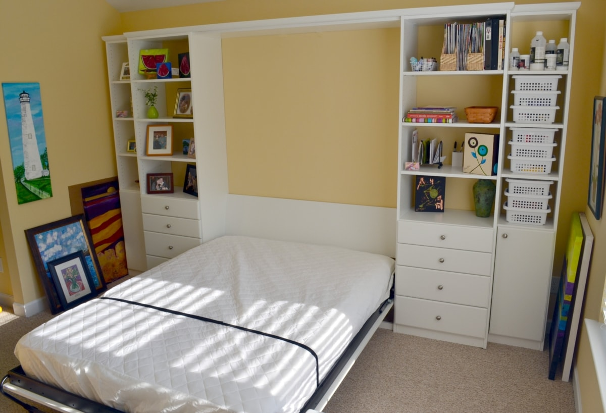 Wall beds etsco sweet dreams come easy in this part time guest room and full time craftart studio thanks to a queen sized wall bed with side storage amipublicfo Images