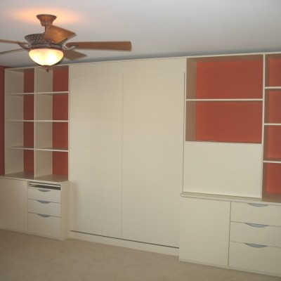 Eclectic design for the non symmetrical fan.  Guest room when needed.  Scrapbook room all the time!