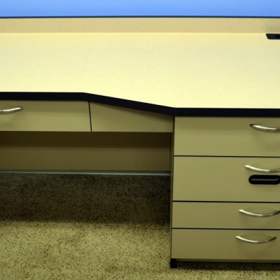 "Refraction Desk in our standard configuration (shown with ""No Cost"" option for tissue slot).  Khaki base with Natural Nebula Top, contrasting Dark Brown edge banding."