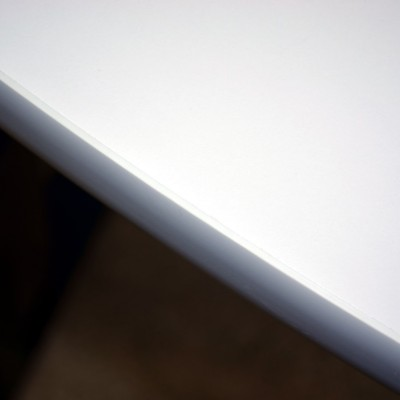"Close up of our 1/8"" ""Bumper"" Edge on our Elevating Tables (also available on our Refraction Desks!).  Comes in Grey, Black, Dark Brown."